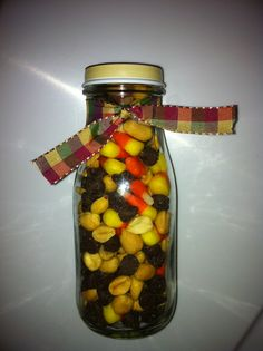 September Teacher Gift - Fall Trail Mix **allergy warning** Glass jar filled with Peanuts, Chocolate Chips (Semi-Sweet) & Candy Corn.  Wrap with a seasonal ribbon and deliver! :)