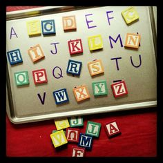 Teaching ABC's to a toddler. Dollar store cookie sheet, magnetic ABC's from Michaels and a sharpie.