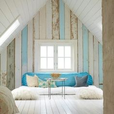I like the wood plank accent wall and the pop of bblue.