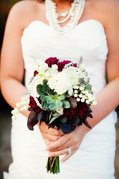 Love the succulents and polka dot guinea feathers in this bouquet