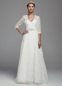 Write your own romance novel on your special day in this exquisite lace gown!  3/4 sleeve all over lace A-line gown with plunging v-neckline that is ultra-feminine and chic.  Dazzling beaded waist is eye-catching and gives you a refined look.  Chapel train. Available in Ivory. Sizes 0-14.  Fully lined. Back zip. Imported. Dry clean only. To preserve your wedding dreams, try our Wedding Gown Preservation Kit.