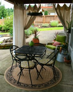 This is what I want to do under our deck. Gather up some unwanted furniture from others and repaint it, make cushions, drop cloth curtains and it could be cheap!! (I like the idea of using drop clothes to make curtains)