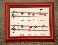 Free music chart printable of God Bless America with fabric covered buttons...stinkin' cute!