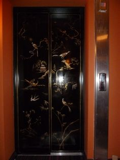 oil and bronze powder painted lift doors.chinoiserie