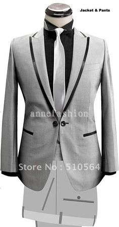Peak lapel trimmed jetted pocket suit with link