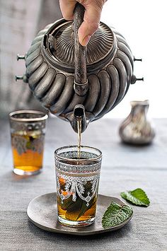 Fresh Moroccan Mint Tea in those impossibly hot but beautiful tea sets.