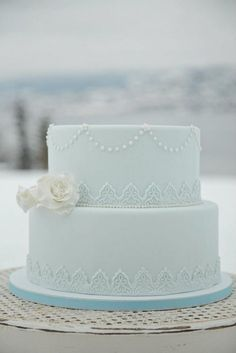 Two-tiered baby blue wedding cake - so gorgeous! #wedding #weddingcake #cake #somethingblue #blue