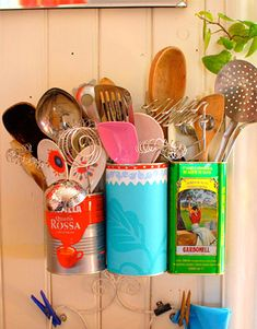 Can-Do Kitchen Organizer  If you like keeping kitchen utensils handy but don't like them sprawling all over your countertops, tack used tin cans to an empty wall space for your stirring spoons, whisks, and spatulas. Find colorful cans at second-hand stores and garage sales. Clothes pins make cheap, handy clips for drying rubber gloves and sponges.