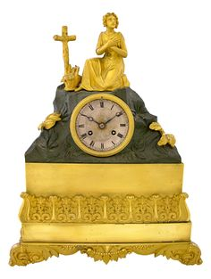 "French First Empire Gilt And Patinated Bronze Mantle Clock, The Hill For Top With A Gilt Bronze Figure Of A Woman At Prayer, A Cross, And A Floral Basket, Over The Engraved Steel Face Marked ""Brisson Villard"" All On A Bright Gilt Bronze Base With Relief Decoration On Four Leaf Scroll And Berry Relief Decorated Feet c.1810"