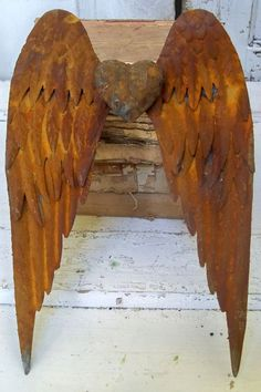 Rusty metal detailed wings wall sculpture by AnitaSperoDesign