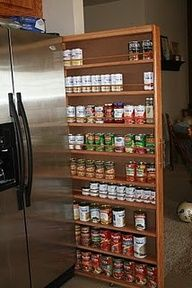 massive space-saving storage idea! perfect extra pantry. See everything at once, great for spices, boxed meals like hamburger helper. And ideal for home canned goods as it keeps them well out of the light! Need to check in w my carpenter co-worker to see what he would want to make me one!