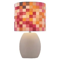 Ceramic table lamp with a fabric drum shade.    Product: Table lamp    Construction Material: Ceramic and fabric