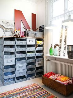 Great craft room idea ... need to figure out where to get those metal bins!