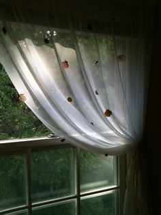 Shell curtains.....cheap WalMart sheers with shells hot glued on!
