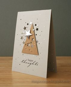 What a simple yet sparkly card!  A tree shape cut from kraft paper, with some small stars punched out of it, really pops on this white card.  Silver and gold stickers or punches add the holiday spirit to this handmade Christmas card.