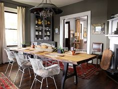 Midcentury-inspired metal chairs surround a maple dining table designed by Robert Ogden. Susan Chancey via Country Living Magazine
