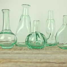 Vintage style glass bottles using recycled glass. Available here: http://www.lightsforalloccasions.com/p-4743-assorted-bud-bottles-and-vases-green-glass-set-of-6.aspx #vintage #vintagebottles #vintagedecor
