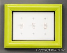 recyle an old picture frame with some fresh paint to dress up a Iight switch