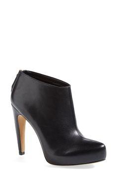 Sleek black booties are a wardrobe staple.