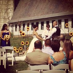 Nikki & Stephen's ceremony in front of the Barn at Perona Farms.  What beautiful sunflowers!