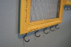 DIY Jewelry Organizer: hooks in the bottom of the frame