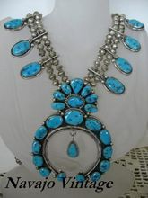 Beautiful Navajo Squash Blossom. Made by Harrison Jim. All natural turquoise. Gorgeous, heavy,I had the Naja made removable so you can wear it on a wire by itself. Fabulous piece of Native American vintage artisanship.