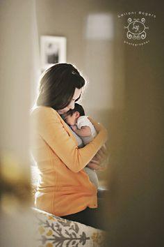 Cute newborn-mother pose