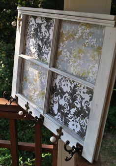 This old window appears to have been re-purposed with some fabric!  I love!  Another idea would be stenciled art on the window panes!