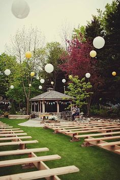 Love the simple benches in this backyard wedding