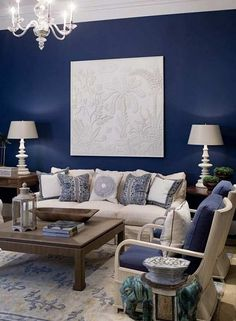 Blue accent wall with cream fabric and dark wood for living room