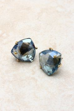 forget big earrings, go for simple sapphire studs.