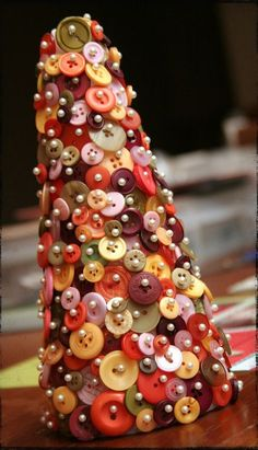 A button tree!  Pins pushed through buttons on to foam forms. Easy and cute!