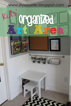 What I especially like about this is the rod with cups of art supplies. The paper in containers on the wall is great too, of course. Using that often overlooked wall space to keep a completely clear table is what makes this space brilliant.