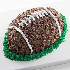 Football Cake made with Nestlé® Crunch® Candy Pieces | Archive content from Modern Baking football cakes, crunch, footbal cake, cakes made with candy, birthday parties, birthday cakes with candy, candi piec, football parties, footbal parti