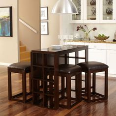 ... table converts from a narrow bar counter that is 18