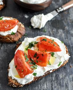 whipped feta topped w/ roasted tomatoes, fresh herbs & roasted garlic oil on multi-grain wheat toast.