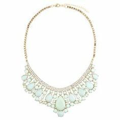 """Add a pop of style to evening ensembles and work outfits alike with this stunning gold-plated necklace, showcasing a cascading bib of faceted mint green beads highlighted by shimmering rhinestones.   Product: NecklaceConstruction Material: Zinc alloy, resin and rhinestonesColor: Mint green and goldFeatures:  Adjustable chain length adds up to 2.5""""Faceted mint green beadsHandmade   Dimensions: Chain: 18""""Stones: 2.25"""" H x 6"""" WCleaning and Care: Avoid all oils and chemicals (such as lotions, ..."""