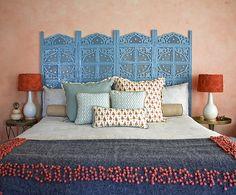 peach bedroom walls, turquoise antique bed, orange, brass, lavender accents. Seldin Design Studios