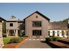 modern farmhouse.  Love the mixed compound look.  Perhaps a smart way to do a phase 1 build with preplanned add ons..