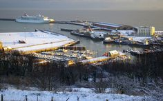 Western Docks and Dover Marina from the Western Heights, Kent, England, UK. Large snow-covered area on left is the old hoverport apron. Below are yachts and boats in the Tidal Harbour, bounded at top by Dolphin Jetty and on the right by Crosswall Quay (building is Dover Lifeboat Station with orange RNLB 17-09 City of London II alongside); Granville Dock below quay. MS Balmoral cruise ship on Admiralty Pier. Winter (December 2009) Travel and Tourism. See: http://www.panoramio.com/photo/30188238