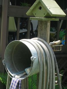 Such a cute way to store hose and other outdoor it...