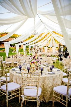 Beautiful tent draping by crown weddings - this is what I want for a little shade from the hot summer sun.