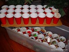 Hot glue cups to cardboard and store Christmas ornaments in them in tubs.   Going to try this one this year
