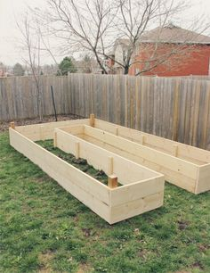Like this design, adds a little extra garden space vs. two separate boxes...How to Build a Raised Garden Bed {via My. Daily. Randomness.}