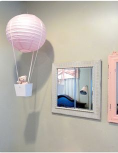 Make this pretty Hot Air Balloon using a pretty pink paper lantern! Hang it in a child's room or use it as decor for a party. #DIY