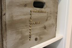 Wooden bins from HomeGoods are monogramed with nail heads for a rustic look  and functional storage. Easy DIY and a great way to personalize a space! #sponsored #happybydesign