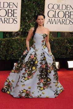Lucy Liu goes ultra-feminine in a floral blue gown by Carolina Herrera.