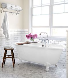 Subway tile and a spectacular tub.