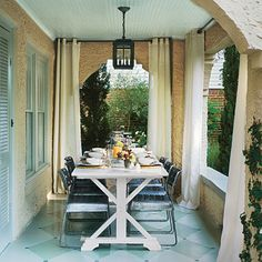 Love this outdoor dining space - the drapes really make it feel like a room.