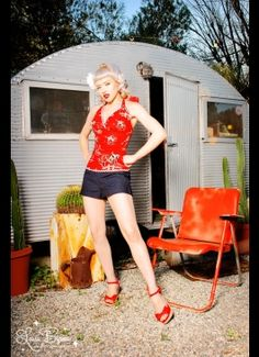 A pinup and a vintage trailer!